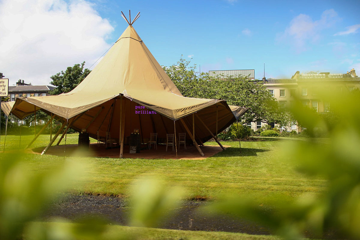 Below Canvas wedding tipi set up in the grounds of Blythswood Square Gardens in Glasgow