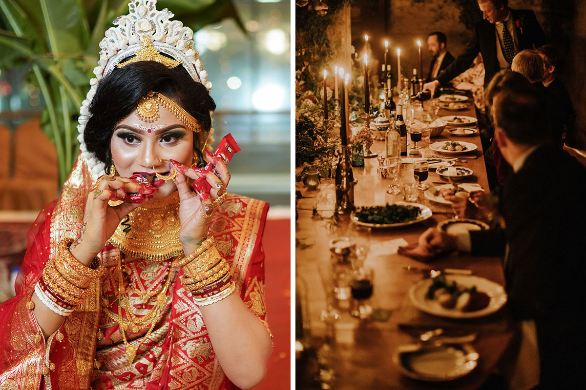 Asian bride wearing red and gold eating chocolate bar and wedding guests talking and eating around candlelit long dinner table