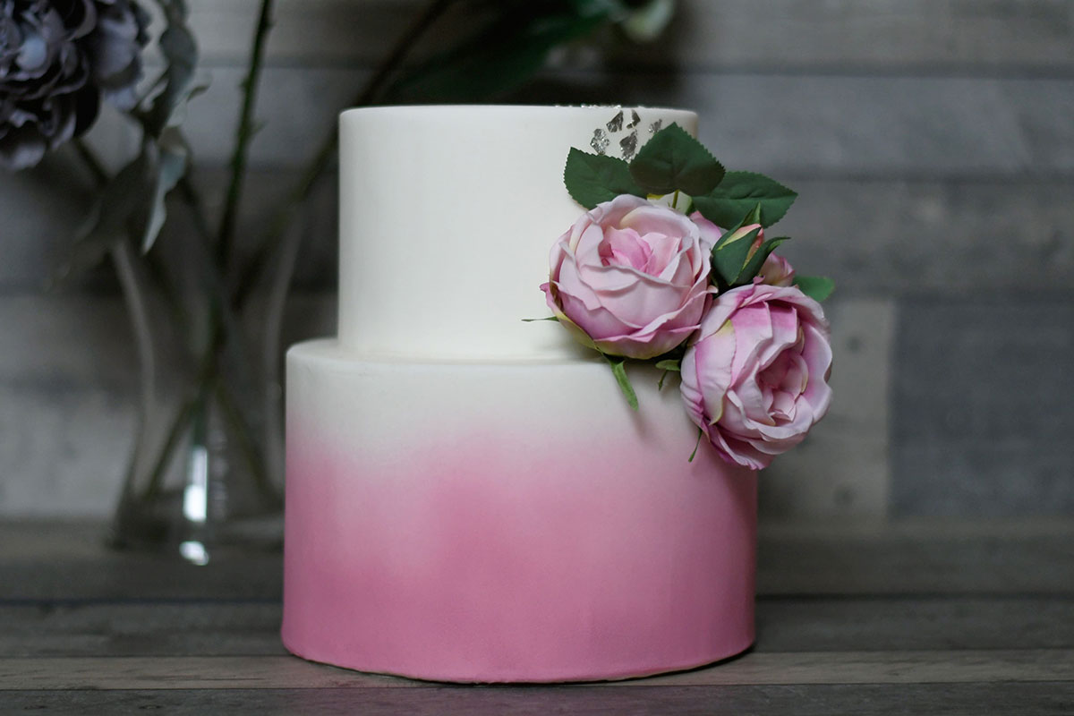 Pink and white ombre effect wedding cake with pink roses by Cake Couture by Caroline