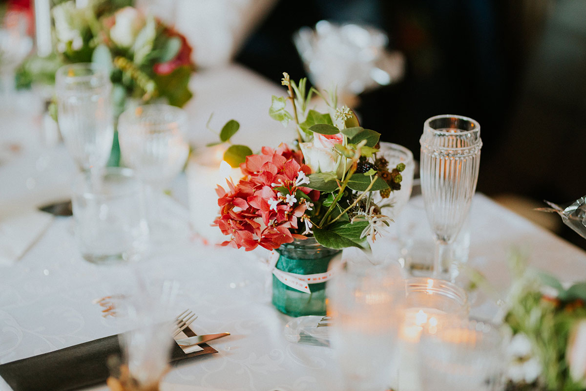 wedding table set up at Jacob's Place in Edinburgh with flowers in jam jars