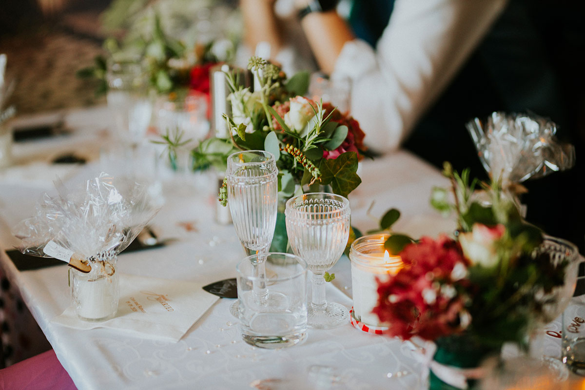 wedding table set up at Jacob's Place with ribbed glassware and flowers