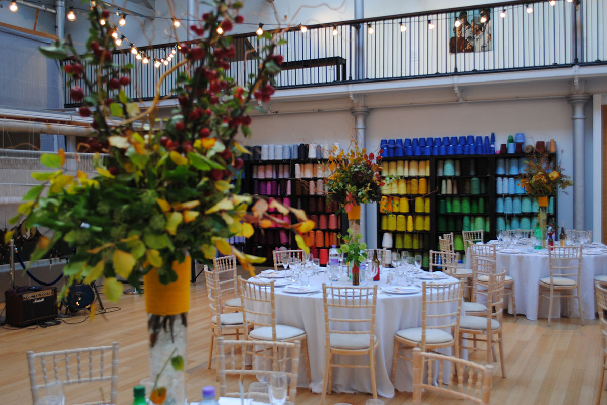 Tables set up for a wedding reception in Dovecot Studios