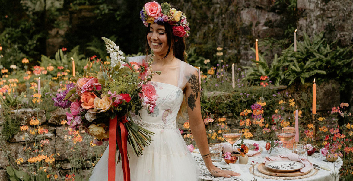 alternative colourful floral wedding styled shoot in summer woodland with bride wearing flower crown