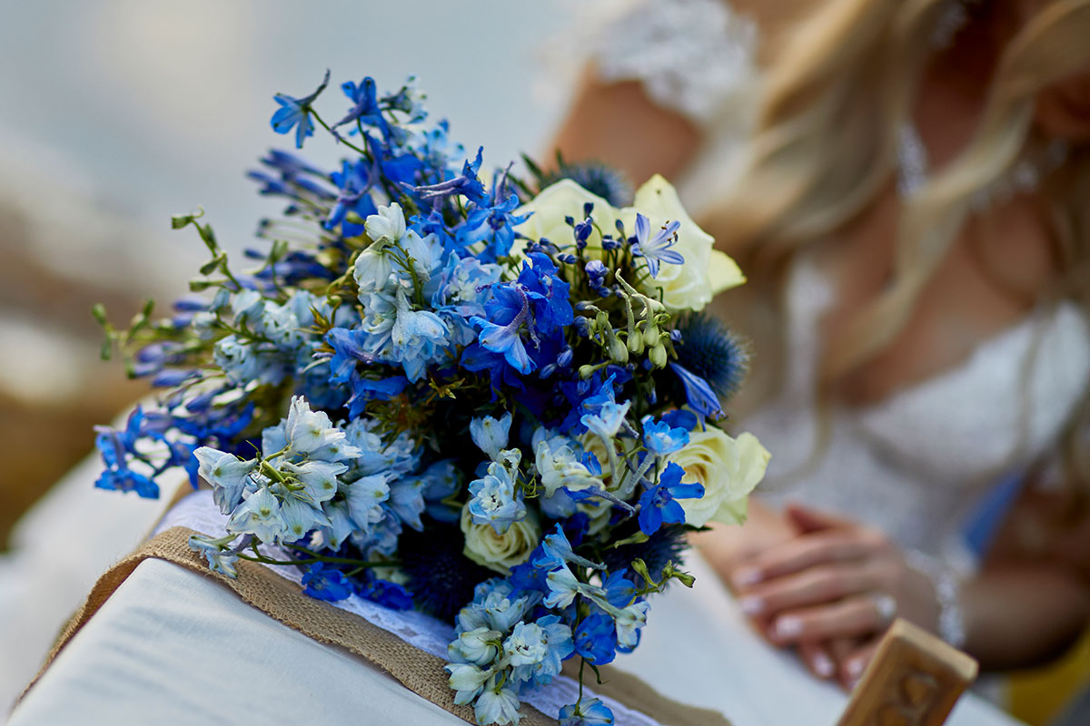blue flowers bridal bouquet sitting on a table