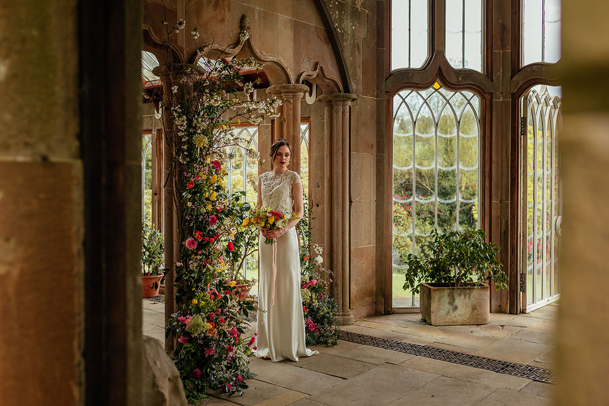 bride standing in the Camellia House at Culzean Castle