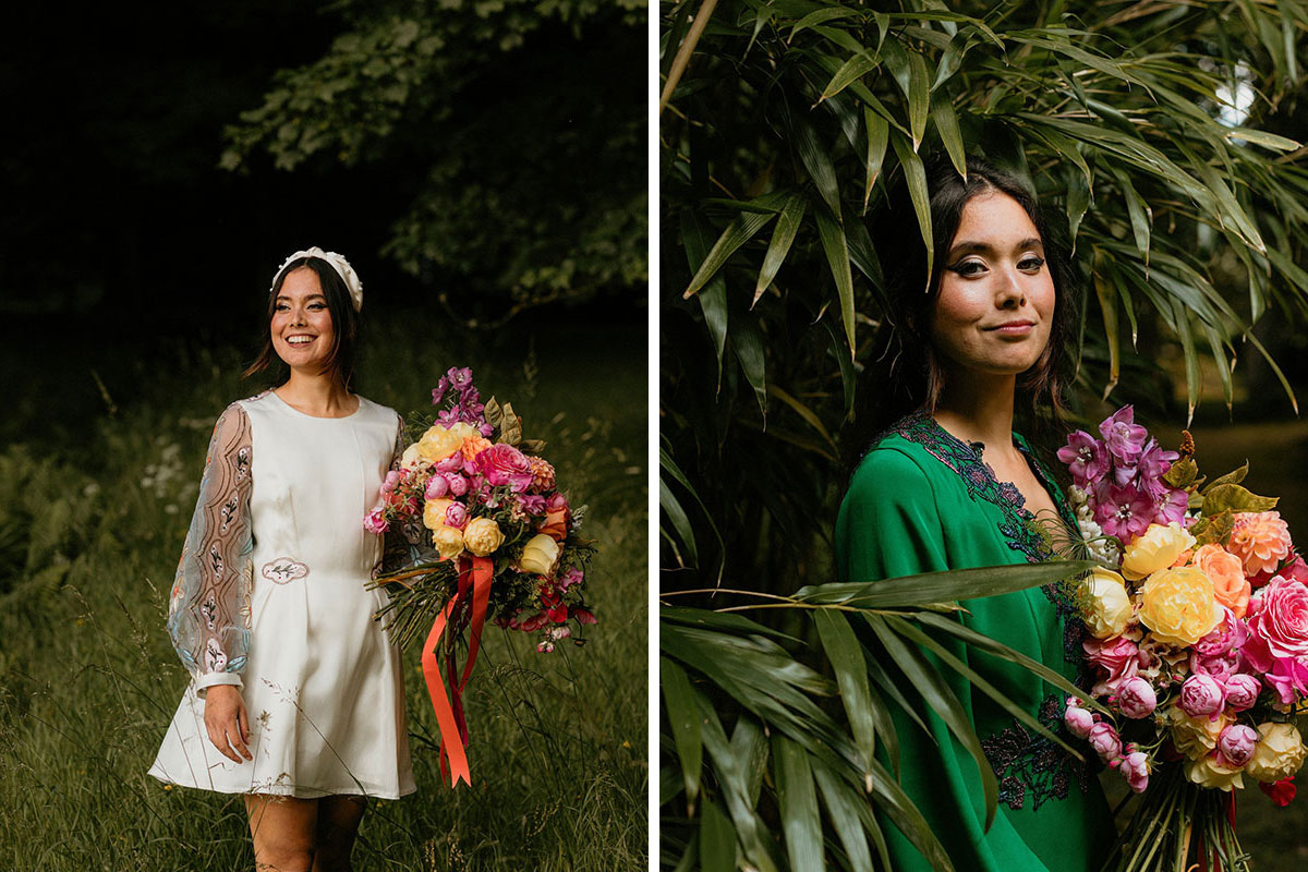 bride walking through grassy field wearing floral-sleeved short dress by Rowan Joy and wearing green dress surrounded by trees