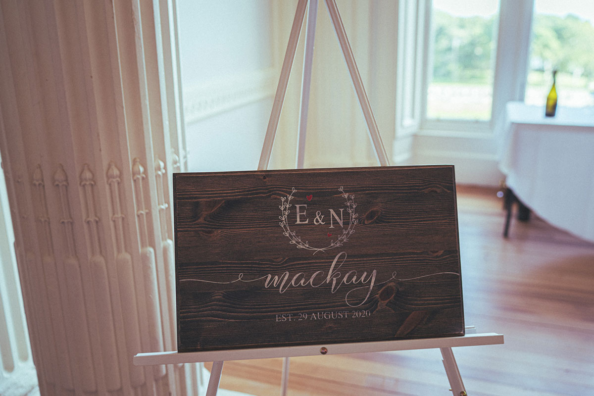 wooden wedding sign on white easel that reads E&N MacKay