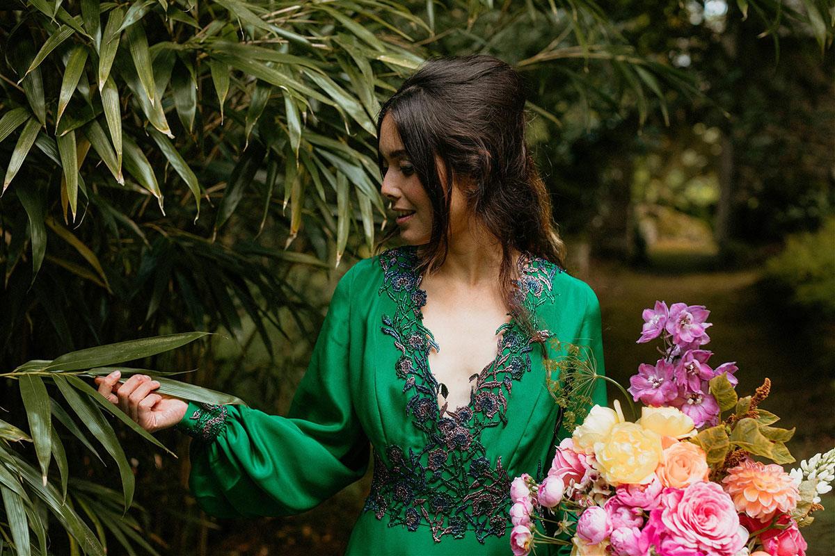 bride wearing green wedding dress by Rowan Joy carrying colourful wedding bouquet by Adelaide's Secret Garden