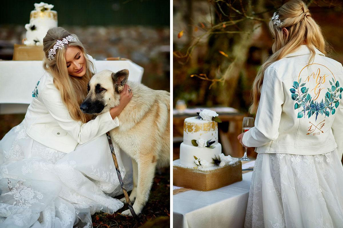bride wearing white personalised denim jacket hugging dog and same bride cutting wedding cake