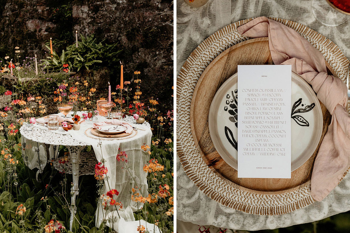 alternative colourful floral wedding styled table in summer woodland with glassware, wedding menu, candles and plates