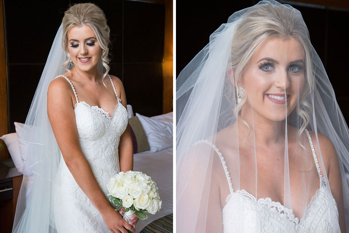a bride wearing a veil and carrying a white bouquet posing for a picture on her wedding day