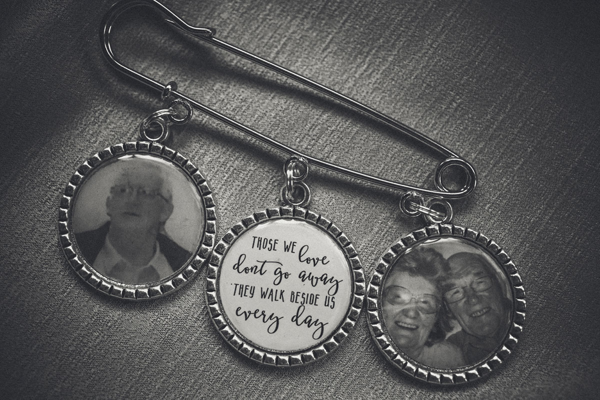 black and white image of three bouquet charms showing deceased relatives and message