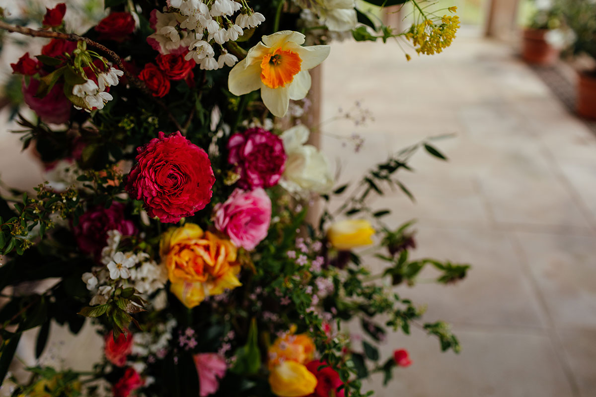 close-up of colourful wedding ceremony flowers by Briar Rose Design