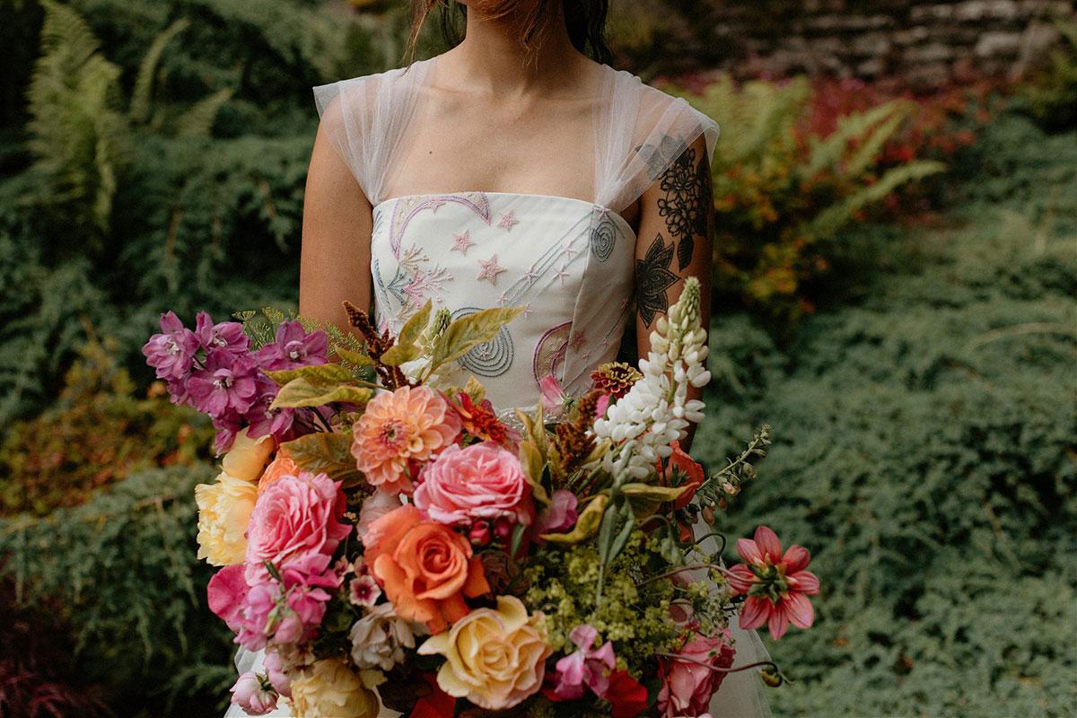 colourful wedding bouquet by Adelaide's Secret Garden and bride wearing dress by Rowan Joy