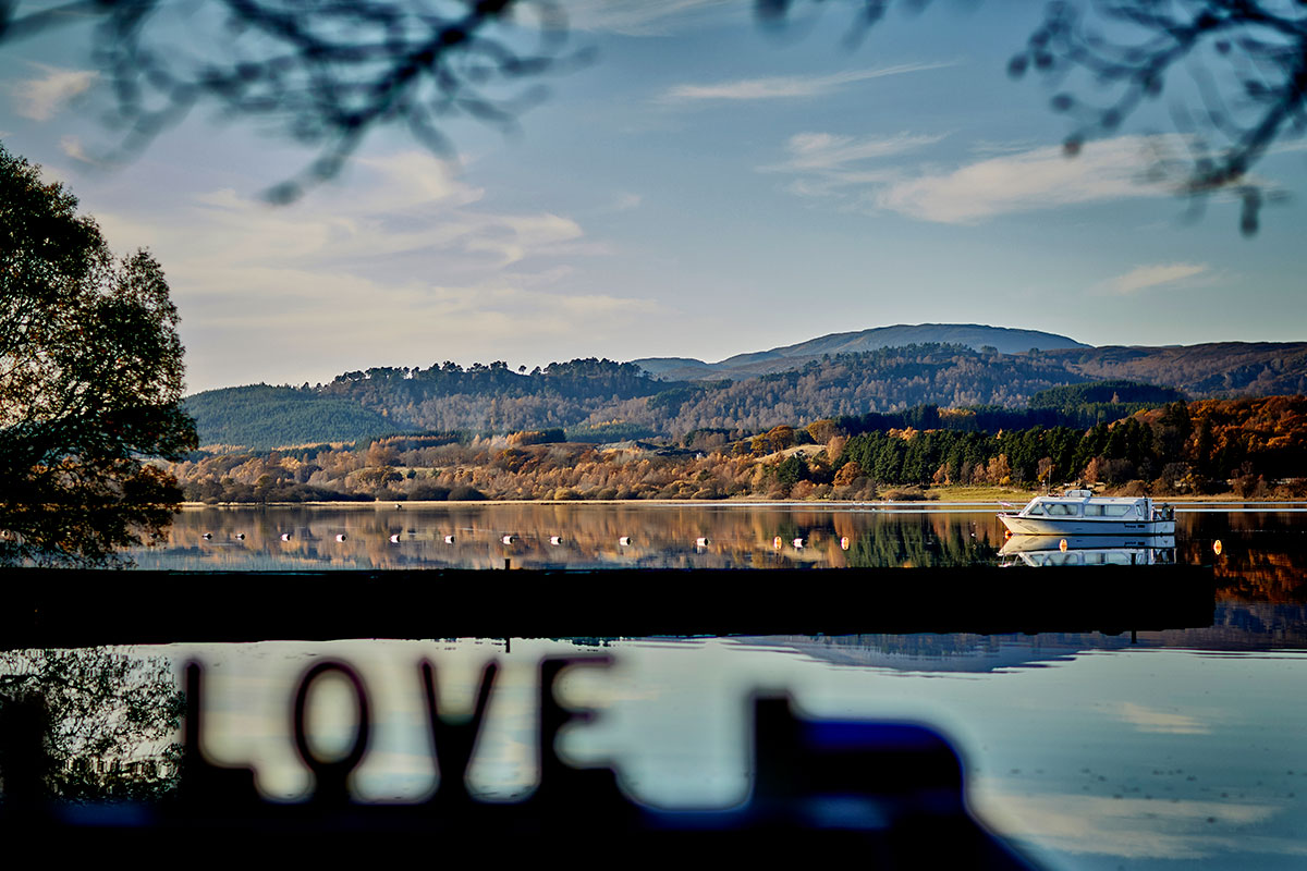 Loch Insh with the word love blurred out in the foreground