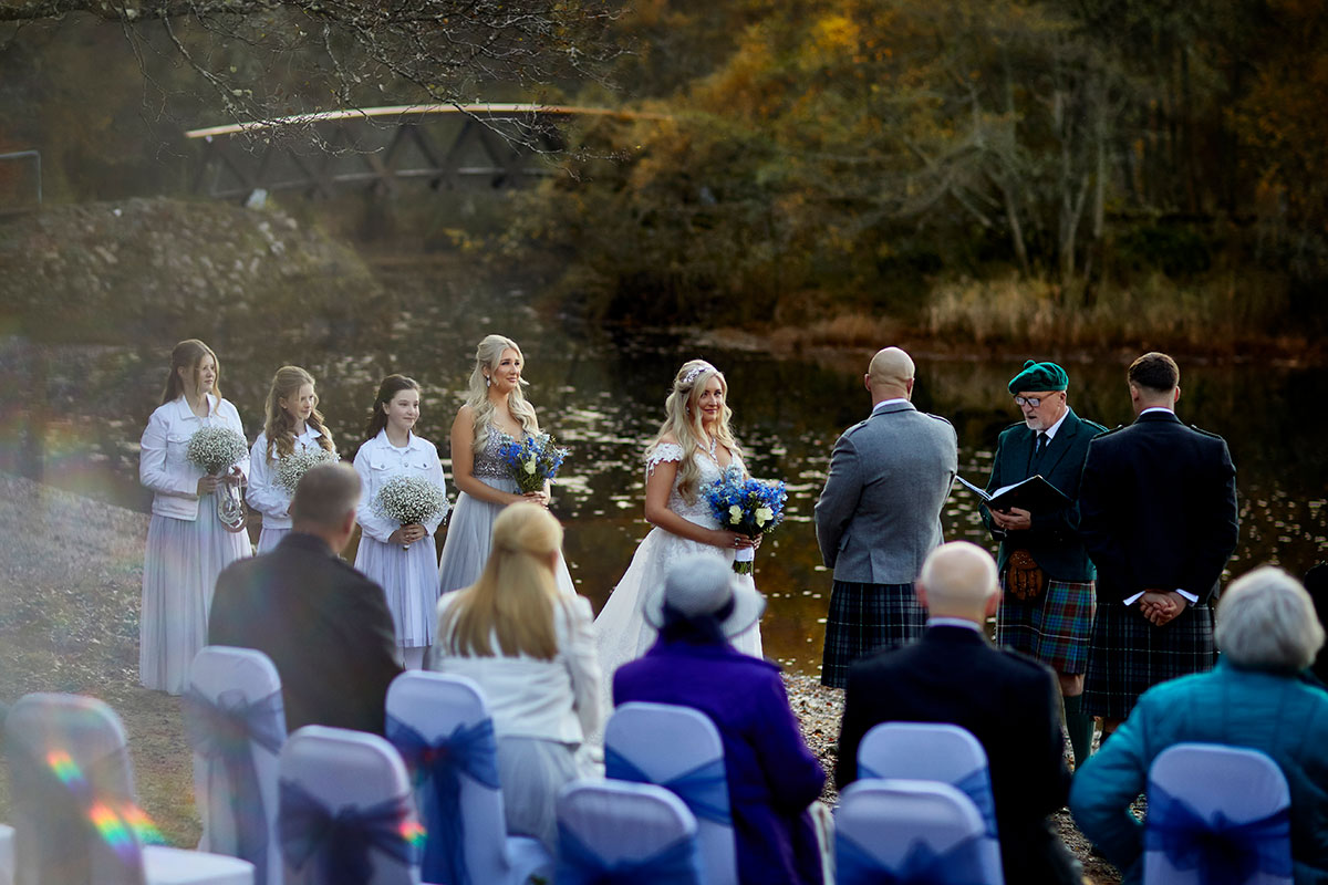 wedding ceremony being conducted by a celebrant on the shore of Loch Insh