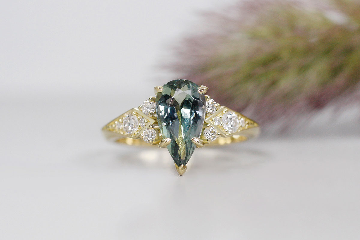 Tanzanite pear shaped stone and diamonds on a yellow gold ring by Brazen Studios