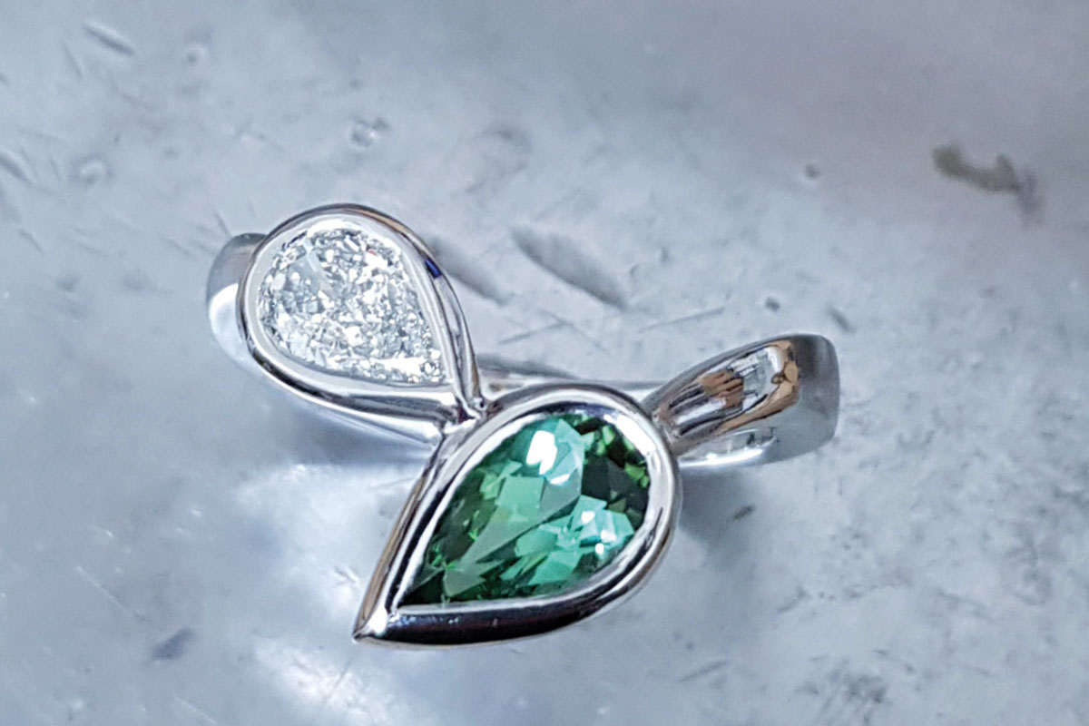 Emerald and diamond pear-shaped stone ring by Lava Jewellery