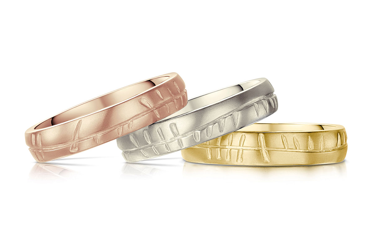 Rose gold, white gold and yellow gold celtic wedding rings by Sheila Fleet