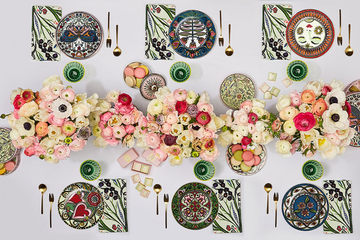 A table set with tableware from the La DoubleJ x Ladurée collection