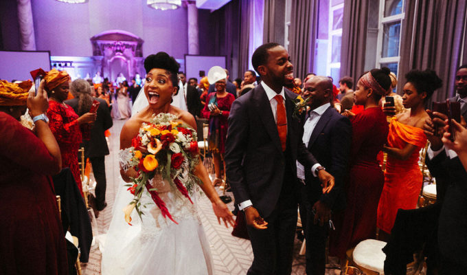 A bride and groom walk down the aisle after exchanging their vows