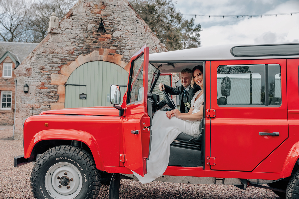 Couple in a red 4x4