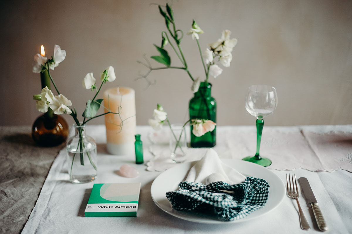 A tablescape accented with pops of green from The Elopement Society