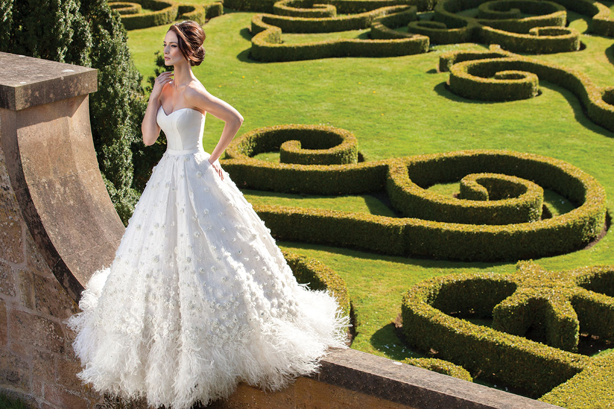 A bride poses in the gardens at Chatelherault