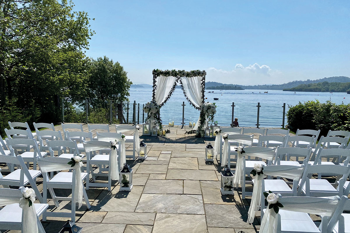 A reception outside at Lodge on Loch Lomond, with views of the loch