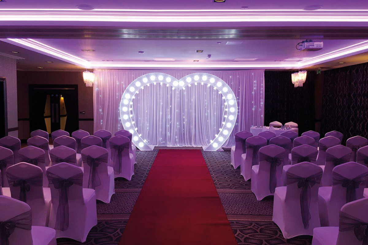 A reception set up featuring a large LED heart at Parklands Hotel and Country Club