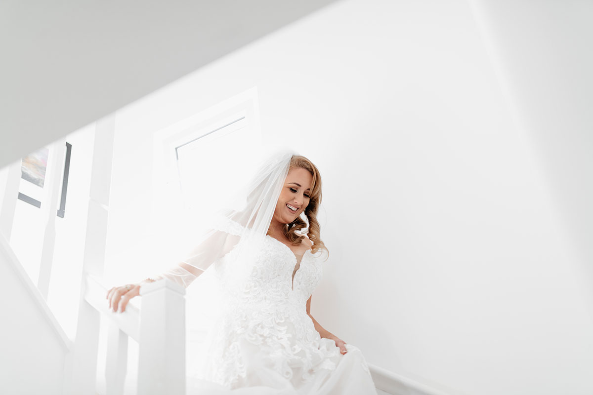 a bride walking downstairs in a house