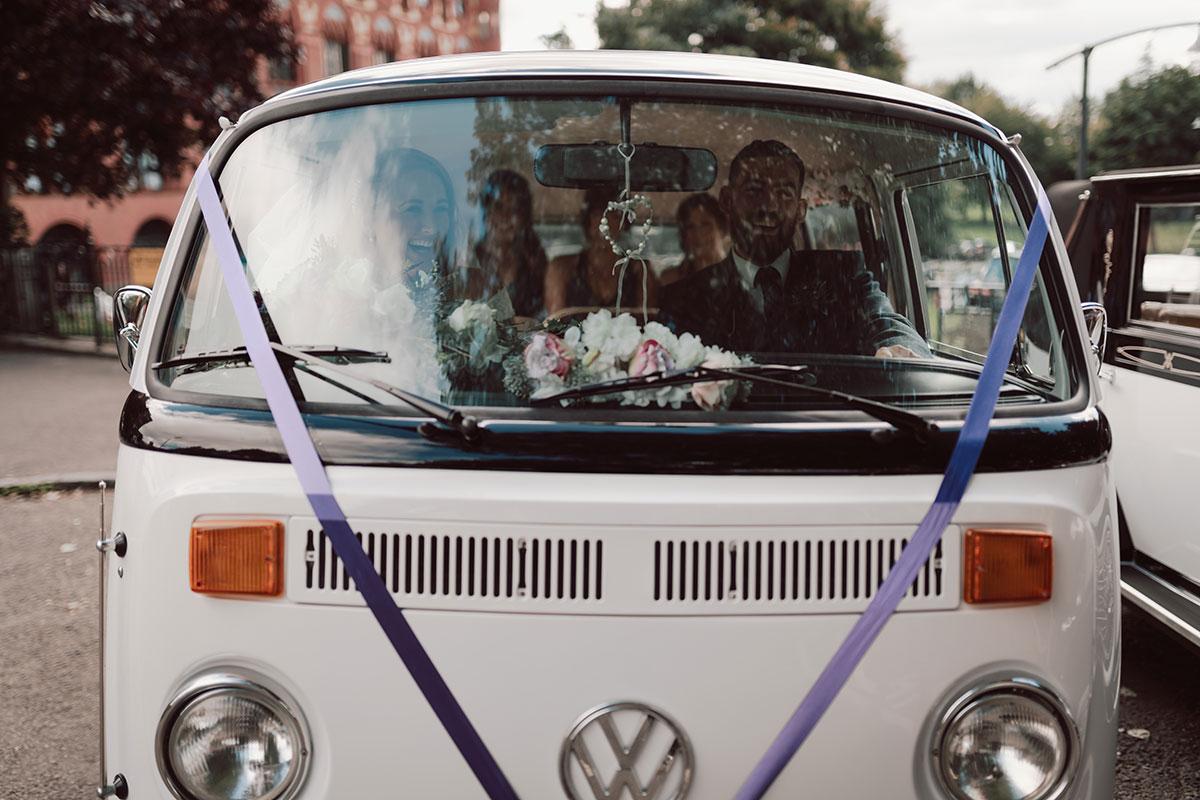 bride and groom inside a white VW camper van parked outside Templeton Carpet Factory