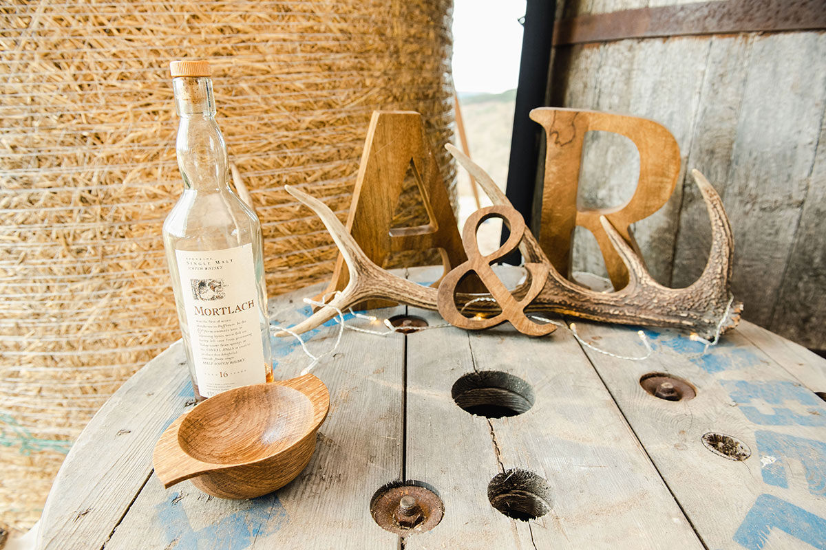 whisky barrel decorated with various rustic wedding props