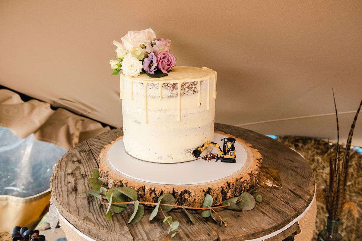 drip wedding cake on log base by Little Croft Bakery