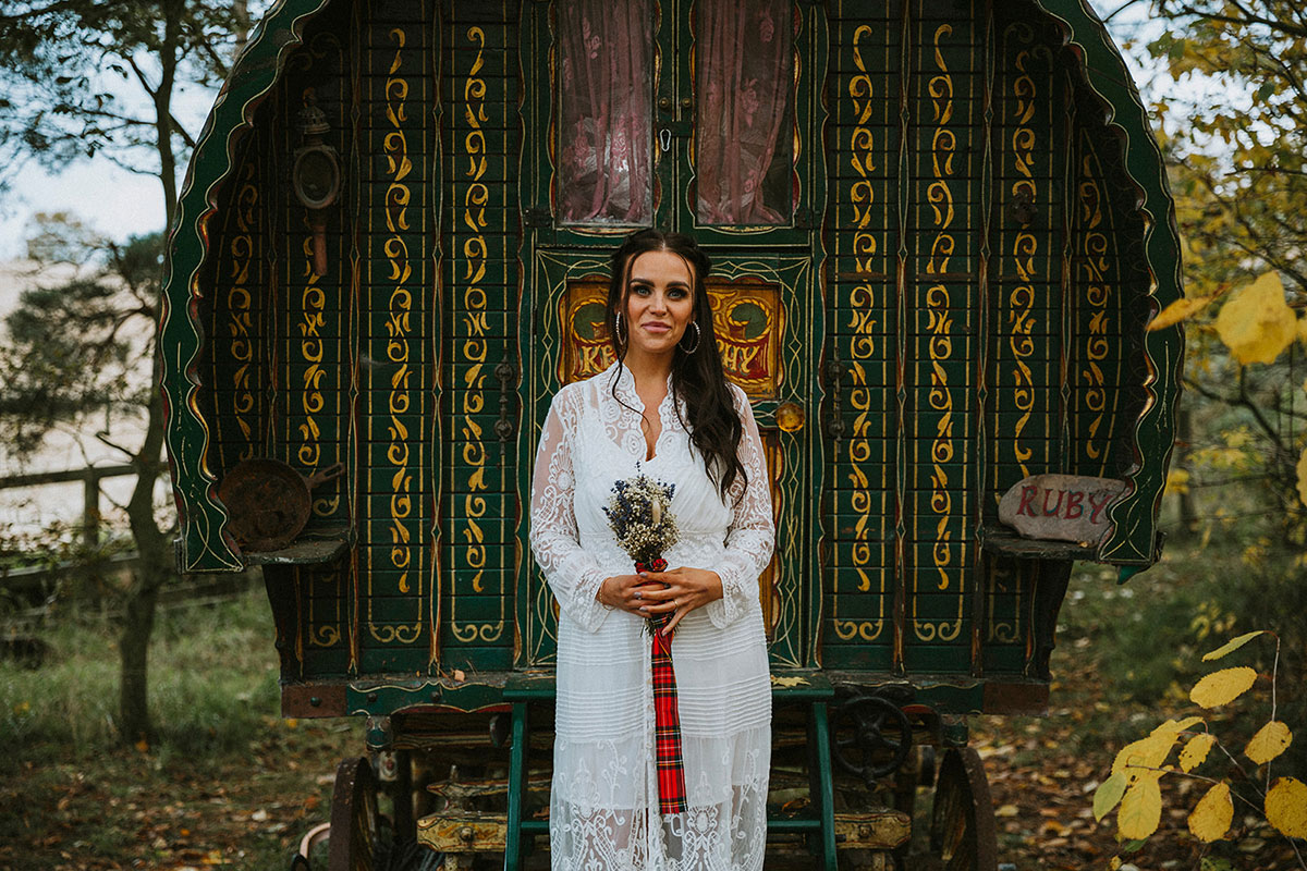 bride standing in front of a roulotte at Roulotte Retreat