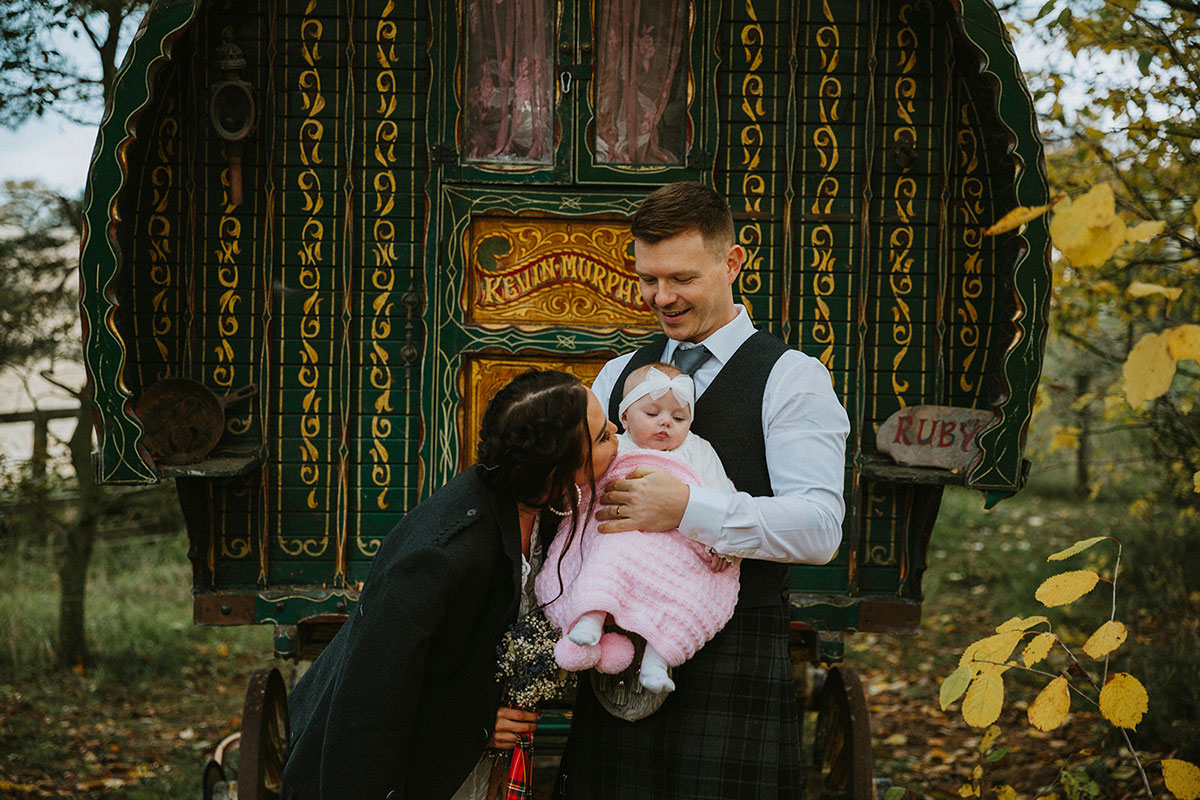 bride, groom and baby at Roulotte Retreat