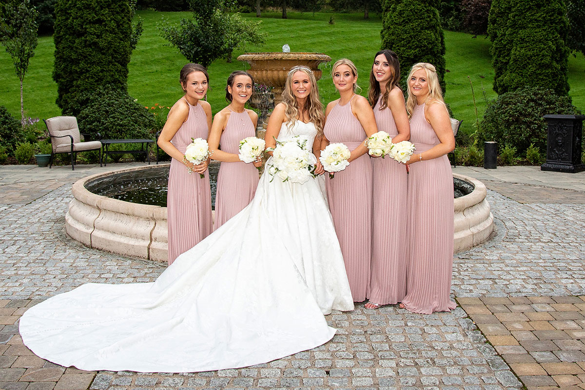 bride with 5 bridesmaids in the grounds of Crossbasket Castle