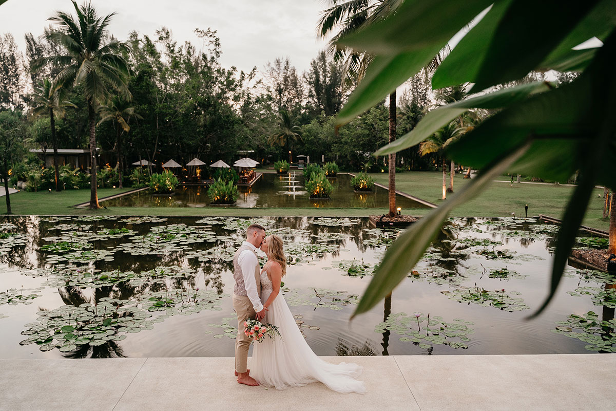 a bride and groom in the grounds of The Sarojin in Khao Lak in Thailand