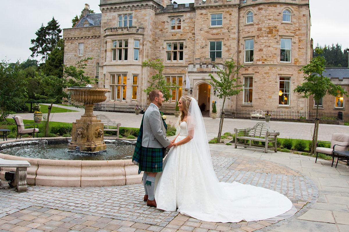 bride and groom outside Crossbasket Castle