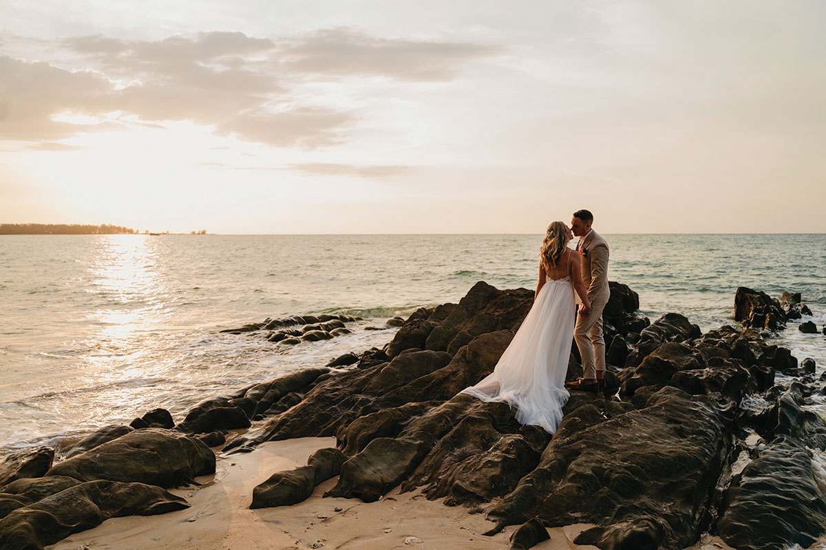 a bride and groom on the beach The Sarojin in Khao Lak in Thailand