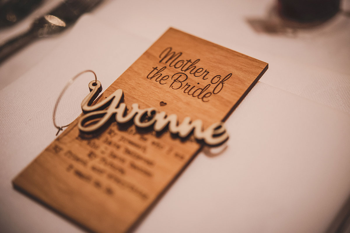 wooden carved mother of the bride place card and name reading Yvonne