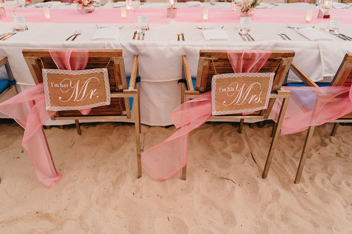 pink tulle and hessian mr and mrs chair decoration on the beach