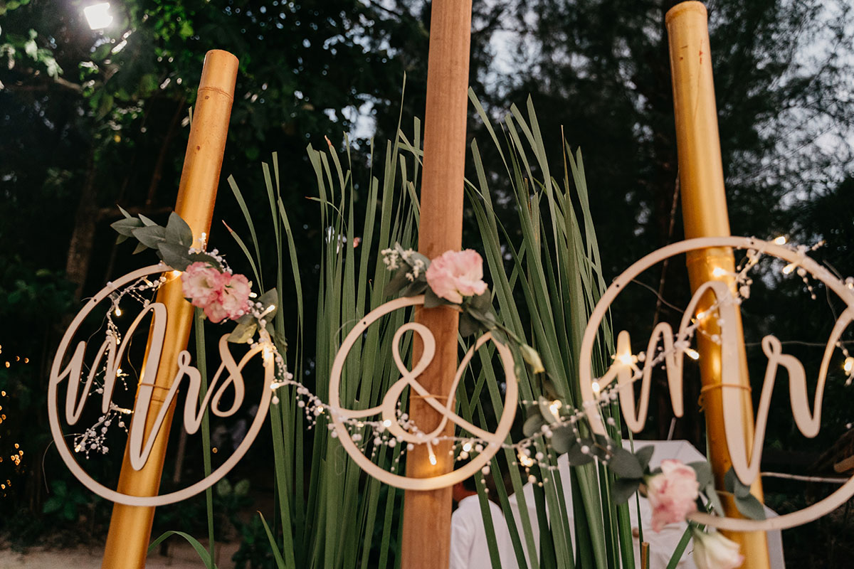 circular wooden laser cut mr and mrs wedding sign with fairy lights