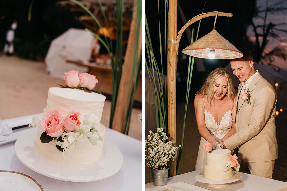 two-tier buttercream wedding cake with flower decoration and bride and groom cutting wedding cake
