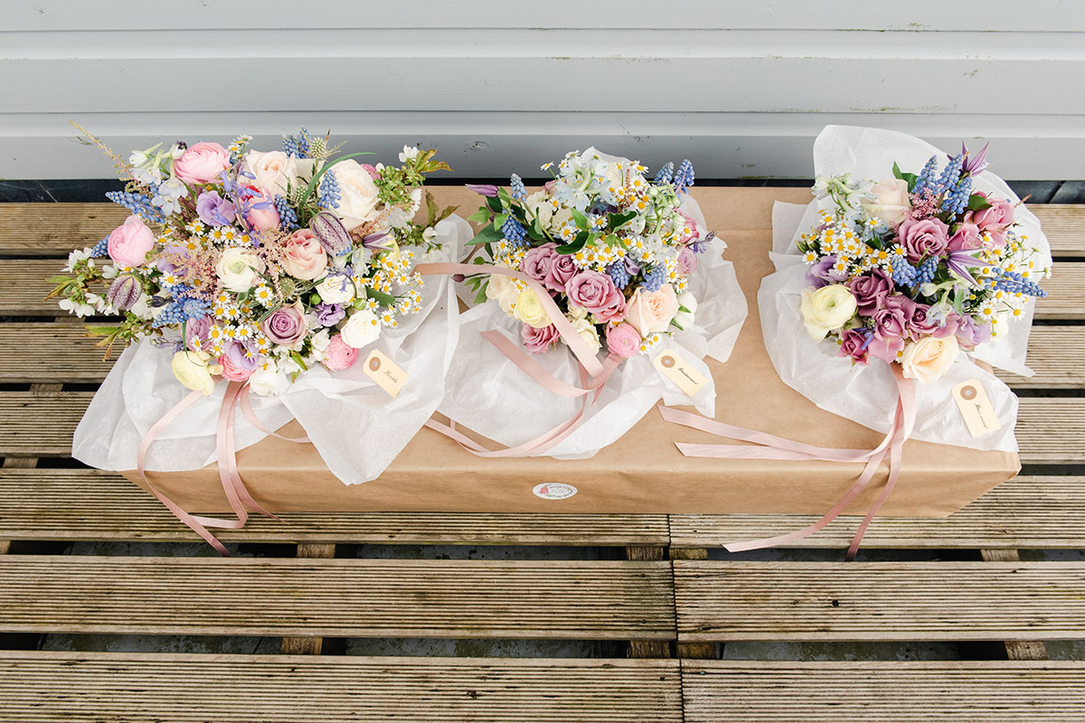 three pastel-coloured wedding bouquets by Bothy Blooms