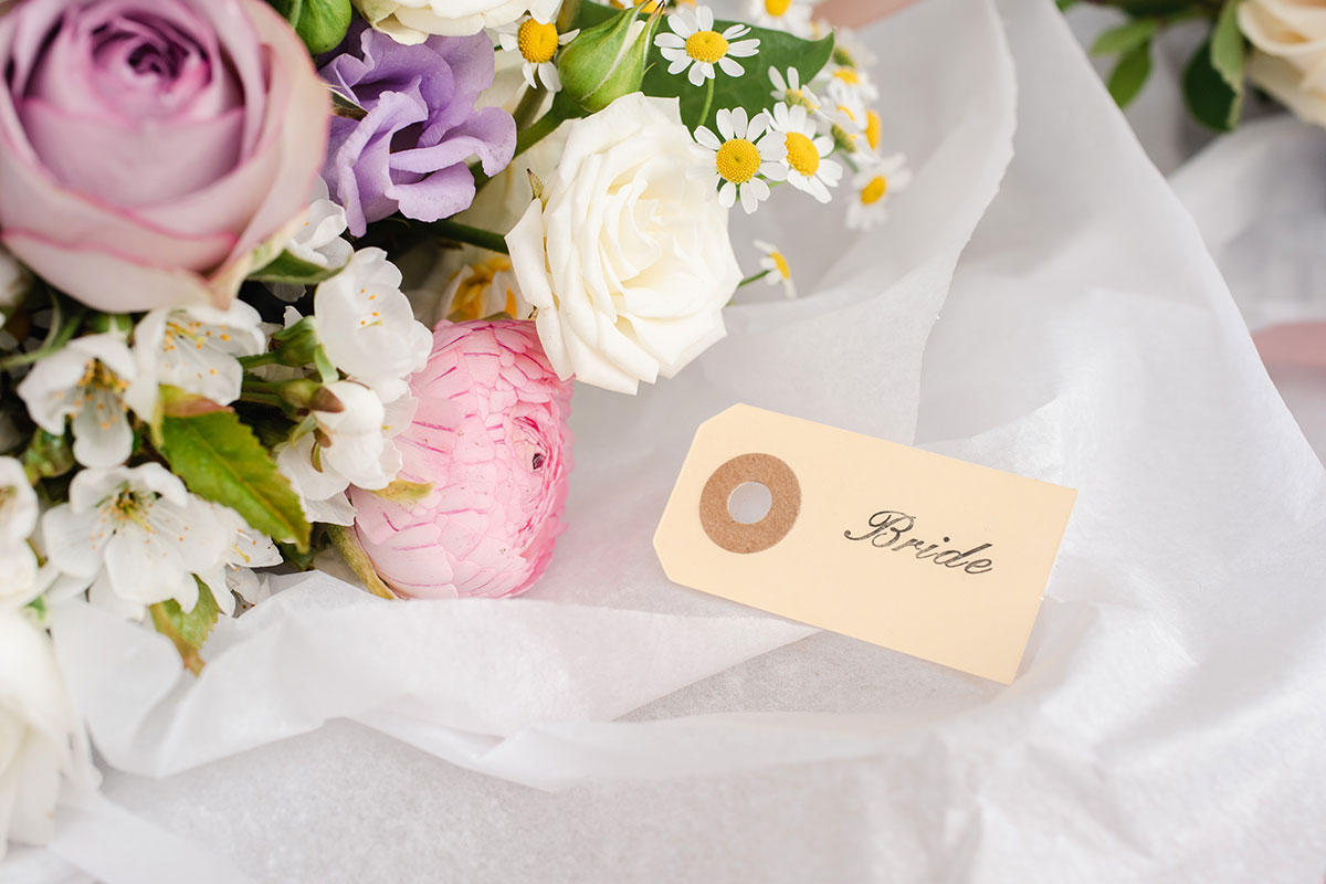 Bride tag on tissue paper with detail of wedding bouquet by Bothy Blooms