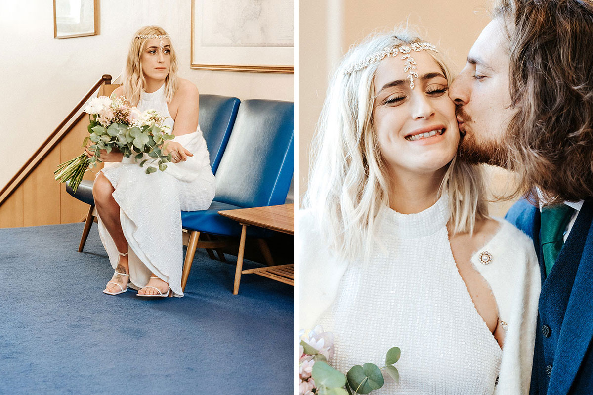 a bride sitting and being kissed by the groom at a wedding ceremony in St Andrews registry office
