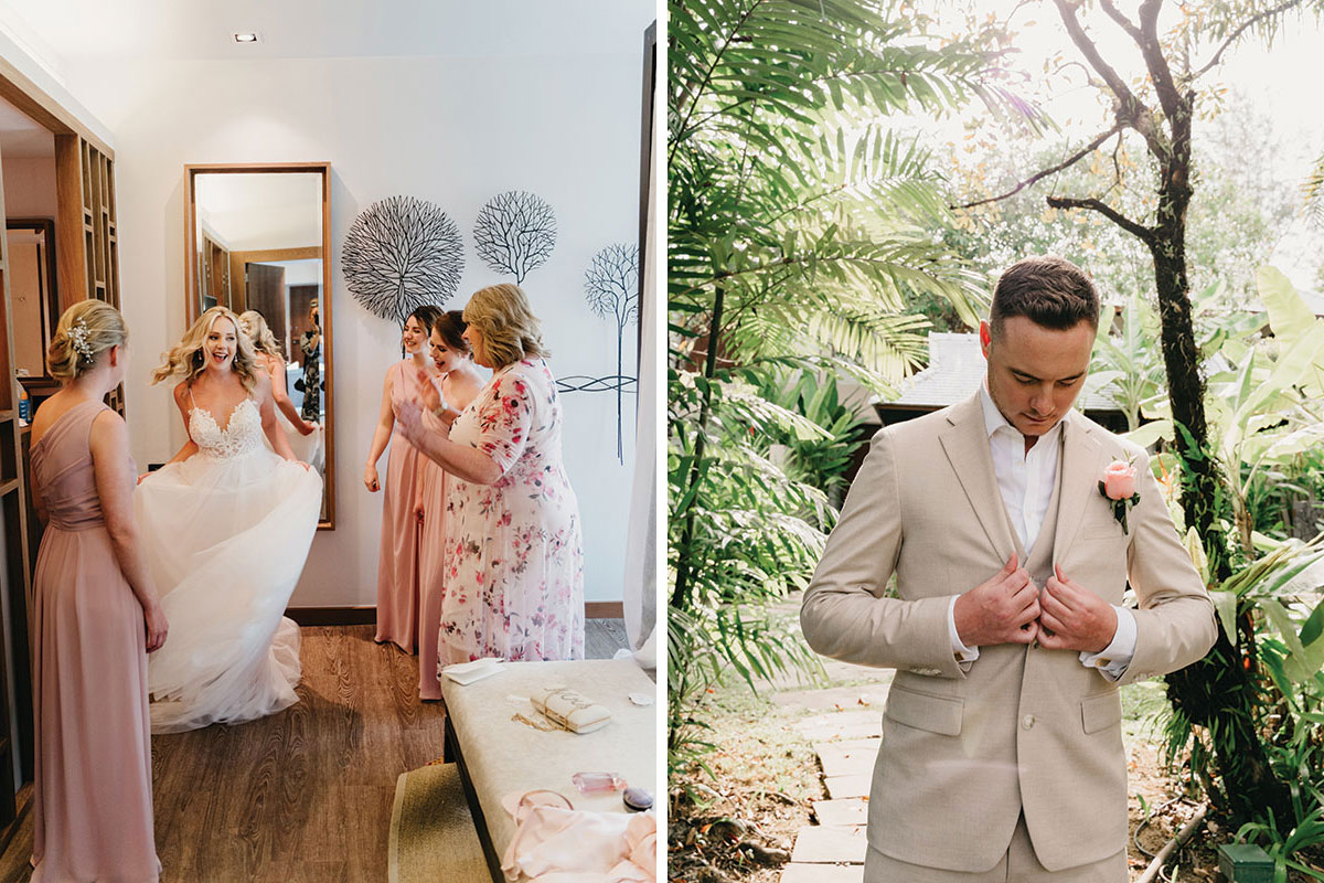 a bride twirling her in wedding dress while bridesmaids look on and a groom fixing his cream wedding suit with tropical trees in background