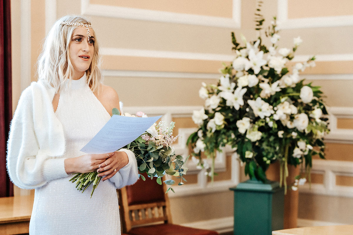 a bride reading her vows at a wedding ceremony at the registry office in St Andrews