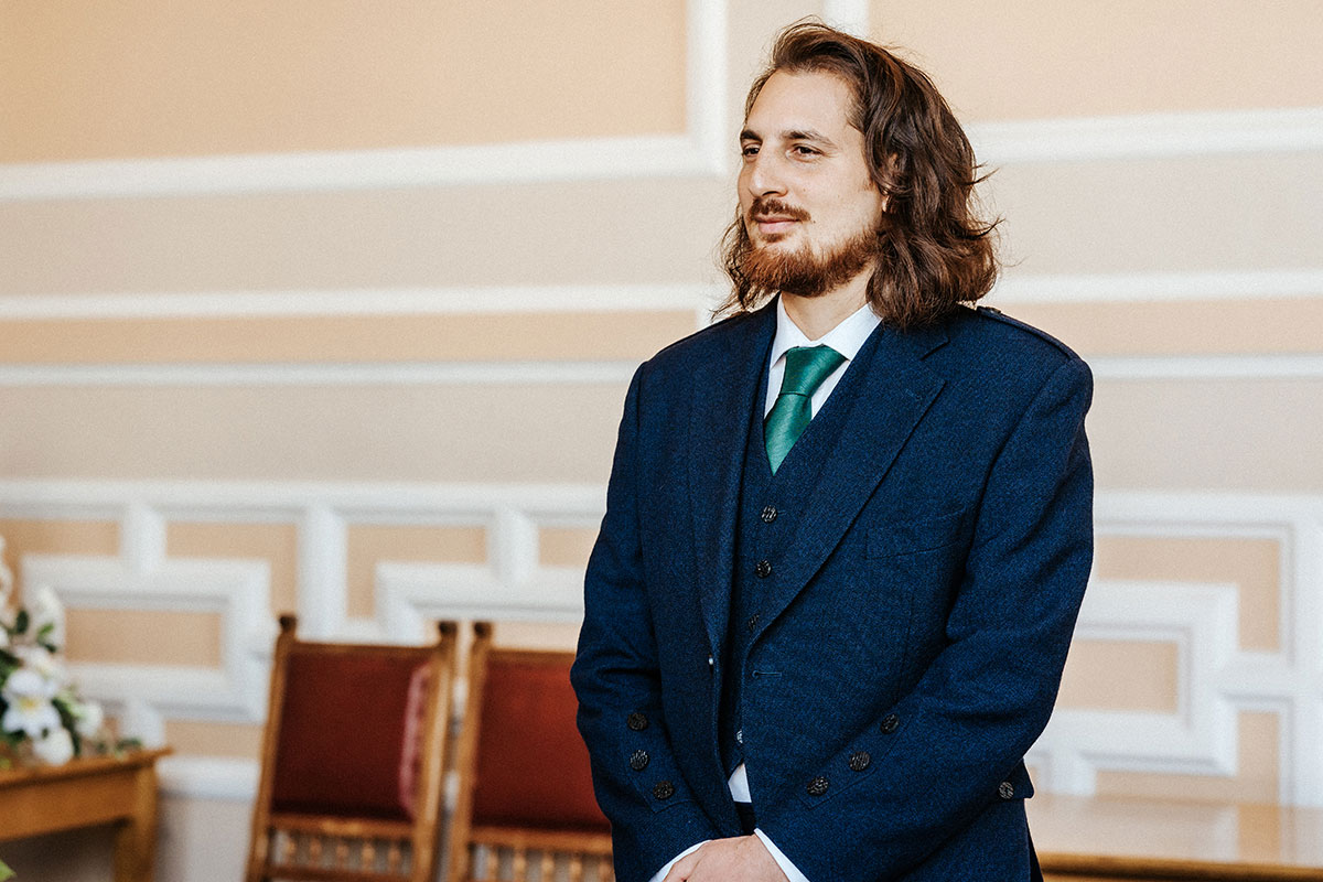 a groom during a wedding ceremony in St Andrews registry office